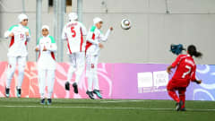 SINGAPORE - AUGUST 24:  Hilal Baskol of Turkey scores a free kick during the bronze medal match between Iran and Turkey in the Girls Youth Olympic Football Tournament at the Jalan Besar Stadium on August 24, 2010 in Singapore, Singapore.  (Photo by Julian Finney - FIFA/FIFA via Getty Images)