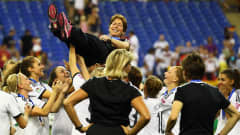 MONTREAL, QC - AUGUST 24:  Head coach Maren Meinert of Germany celebrates with the team after winning the FIFA U-20 Women's World Cup Canada 2014 final match between Nigeria and Germany at Olympic Stadium on August 24, 2014 in Montreal, Canada.  (Photo by Alex Grimm - FIFA/FIFA via Getty Images)