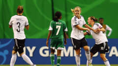 Lena Petermann #18 of Germany celebrates her team's first goal with team mates during the FIFA U-20 Women's World Cup Canada 2014 final match between Nigeria and Germany at Olympic Stadium on August 24, 2014 in Montreal, Canada.  (Photo by Alex Grimm - FIFA/FIFA via Getty Images)