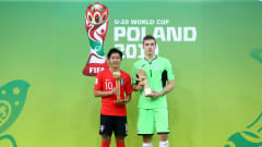 LODZ, POLAND - JUNE 15: Kangin Lee of Korea Republic poses with his Adidas Golden Ball Award and Andriy Lunin of Ukraine poses with his Adidas Golden Glove Award following the 2019 FIFA U-20 World Cup Final between Ukraine and Korea Republic at Lodz Stadium on June 15, 2019 in Lodz, Poland. (Photo by Lars Baron - FIFA/FIFA via Getty Images)