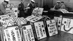 1,400 new road signs were erected in anticipation of the 1966 FIFA World Cup. Here, on 23 June, just 19 days prior to the opening game of the tournament on 11 July officers of the Automobile Association inspect some of the signs.