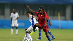 NANJING, CHINA - AUGUST 25: Marity Sep (R) of Papua New Guinea battles with Asteria Angula of Namibia during the 2014 FIFA Girls Summer Youth Olympic Football Tournament 5th/6th Place Playoff match between Papua New Guinea and Namibia at Jiangning Sports Centre Stadium on August 25, 2014 in Nanjing, China.  (Photo by Stanley Chou - FIFA/FIFA via Getty Images)