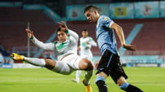 TRABZON, TURKEY - JULY 10:  Mustafa Nadhim (L) of Iraq and Nicolas Lopez of Uruguay compete for the ball during the FIFA U-20 World Cup Semi Final match between Iraq and Uruguay at Huseyin Avni Aker Stadium on July 10, 2013 in Trabzon, Turkey.  (Photo by Joern Pollex - FIFA/FIFA via Getty Images)