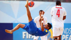 ESPINHO, PORTUGAL - JULY 18: Gabriele Gori of Italy does a scissor kick next to Heimanu Taiarui of Tahiti during the FIFA Beach Soccer World Cup Portugal 2015 Semi-final match between Italy and Tahiti at Espinho Stadium on July 18, 2015 in Espinho, Portugal.  (Photo by Alex Grimm - FIFA/FIFA via Getty Images)