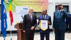 FIFA President Gianni Infantino poses for a photo with President of the Congolese Football Association (FECOFOOT President) Jean-Guy Blaise Mayolas and Minister of Sport Hugues Ngouélondélé at Brazzaville's FIFA Regional Development Office inauguration