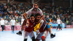 BUENOS AIRES, ARGENTINA - OCTOBER 18:  Moustafa Abdelmagid #9, Belal Elsayed #7 and Youssif Mohsen #10 of Egypt celebrate their 5-4 win over Argentina in the Men's Futsal 3rd Place match between Egypt and Argentina during the Buenos Aires Youth Olympics 2018 at Tecn—polis on October 18, 2018 in Buenos Aires, Argentina.  (Photo by Kevin C. Cox - FIFA/FIFA via Getty Images)