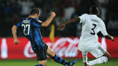 ABU DHABI, UNITED ARAB EMIRATES - DECEMBER 18:  Goran Pandev (L) of FC Internazionale Milano scores the opening goal past Kiritcho Kasusula of TP Mazembe Englebert during the FIFA Club World Cup final match between TP Mazembe Englebert and FC Internazionale Milano at Zayed Sports City on December 18, 2010 in Abu Dhabi, United Arab Emirates.  (Photo by Jasper Juinen - FIFA/FIFA via Getty Images)