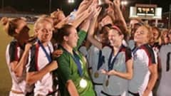 USA celebrate with the CONCACAF U-17 Women's Championship trophy after beating Costa Rica 4-1 in the final.