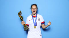Carli Lloyd of USA takes a photo with the France 2019 trophy