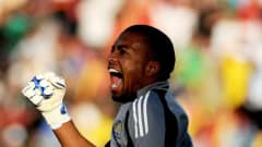 RUSTENBURG, SOUTH AFRICA - JUNE 28: Itumeleng Khune of South Africa celebrates his team's first goal during the FIFA Confederations Cup 3rd Place Playoff between Spain and South Africa at the Royal Bafokeng Stadium on June 28, 2009 in Rustenburg, South Africa. (Photo by Jasper Juinen/Getty Images)