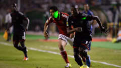 Al-Ahly's Egyptian midfielder Abdallah El-Said (L) fight for the ball against Orlando Pirates' South African defender Thabo Matlaba (R)
