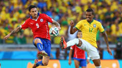 BELO HORIZONTE, BRAZIL - JUNE 28:  Mauricio Pinilla of Chile and Luiz Gustavo of Brazil compete for the ball during the 2014 FIFA World Cup Brazil round of 16 match between Brazil and Chile at Estadio Mineirao on June 28, 2014 in Belo Horizonte, Brazil.  (Photo by Quinn Rooney/Getty Images)