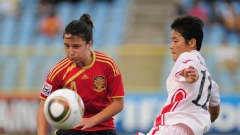 Kim Su Gyong of North Korea challenges Ivana Andres of Spain during the FIFA U17 Women's World Cup 3rd Place Playoff match between Spain and North Korea at the Hasely Crawford Stadium on September 25, 2010 in Port of Spain, Trinidad And Tobago. (Photo by Shaun Botterill - FIFA/FIFA via Getty Images)