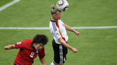 BOCHUM, GERMANY - JULY 29:  Alexandra Popp (R) of Germany and Kim Narae (L) of South Korea battle for the ball during the FIFA U20 Women's World Cup Semi  Final match between Germany and South Korea at the FIFA U-20 Women's World Cup stadium on July 29, 2010 in Bochum, Germany.  (Photo by Friedemann Vogel - FIFA/FIFA via Getty Images)