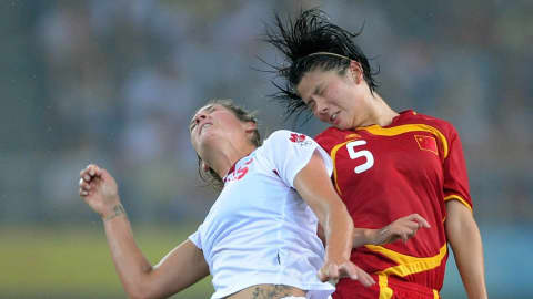 Weng Xinzhi(CHN) and Kara Lang(CAN), vying for the ball in the match between China and Canada (Group E) at the Tianjin Olympic Sports Center Stadium on 9 August 2008.