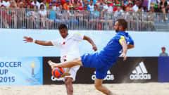 ESPINHO, PORTUGAL - JULY 16: Heiarii Tavanae (L) of Tahiti is challenged by Francesco Corosiniti of Italy during the FIFA Beach Soccer World Cup Portugal 2015 Quarter-final match between Italy and Japan at Espinho Stadium on July 16, 2015 in Espinho, Portugal.  (Photo by Alex Grimm - FIFA/FIFA via Getty Images)