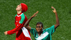 Felicidad Avomo of Equatorial Guinea celebrates scoring during the semi final match between Equatorial Guinea and Iran in the Girls Youth Olympic Football Tournament at the Jalan Besar Stadium on August 21, 2010 in Singapore, Singapore.