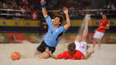 DUBAI, UNITED ARAB EMIRATES - NOVEMBER 21: Parrillo of Uruguay is fouled by Stephan Leu of Switzerland during the FIFA Beach Soccer World Cup Semi Final match between Switzerland and Uruguay at Umm Suqeim beach on November 21, 2009 in Dubai, United Arab Emirates. (Photo by Michael Regan - FIFA/FIFA via Getty Images)