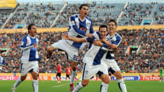 Players of Pachuca celebrate scoring against Al Ahly