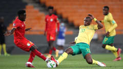 Amanuel Yohannes of Ethiopia and Njabulo Ngcobo of South Africa challenge for possession during the Qatar 2022 FIFA World Cup qualifier between South Africa and Ethiopia held at the the FNB Stadium in Johannesburg, South Africa on 12 October 2021 © Gavin Barker/BackpagePix