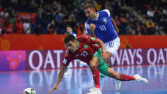 VILNIUS, LITHUANIA - SEPTEMBER 26: Hamza Bouyouzan of Morocco battles for possession with Pito of Brazil during the FIFA Futsal World Cup 2021 Quarter Final match between Morocco and Brazil at Vilnius Arena on September 26, 2021 in Vilnius, Lithuania. (Photo by Alex Caparros - FIFA/FIFA via Getty Images)