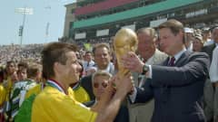 Brazil captain Dunga receives the FIFA World Cup Trophy from US Vice-President Al Gore after the USA 1994 Final