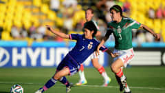 LIBERIA, COSTA RICA - MARCH 27:  Rikako Kobayashi battls with Venessa Flores of Mexico during the FIFA U-17 Women's World Cup Quarter Final match between Japan and Mexico at Edgardo Baltodano Briceno on March 27, 2014 in Liberia, Costa Rica.  (Photo by Jamie McDonald - FIFA/FIFA via Getty Images)