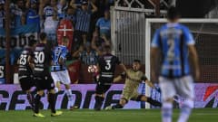 Luan of Gremio shoots to score the secong goal