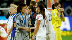 FRANKFURT AM MAIN, GERMANY - JULY 17:  The team of USA congratulates Japan and Hope Solo (R) of USA looks dejected during the FIFA Women's World Cup Final match between Japan and USA at the FIFA World Cup stadium Frankfurt on July 17, 2011 in Frankfurt am Main, Germany.  (Photo by Friedemann Vogel/Getty Images)