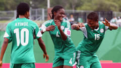 MONCTON, NB - AUGUST 17:  Asisat Oshoala (C) of Nigeria celebrates her team's second goal with team mates Ugo Njoku (R) and Halimatu Ayinde during the FIFA U-20 Women's World Cup Canada 2014 Quarter Final match between Nigeria and New Zealand at Moncton Stadium on August 17, 2014 in Moncton, Canada.  (Photo by Alex Grimm - FIFA/FIFA via Getty Images)