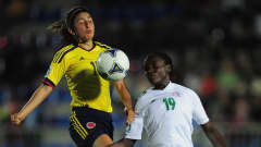 BAKU, AZERBAIJAN - SEPTEMBER 29: Maria Jaramillo of Colombia battles with Chinwendu Ihezuo of Nigeria during the FIFA U-17 Women's World Cup 2012 Group A match between Colombia and Nigeria at Bayil Stadium on September 29, 2012 in Baku, Azerbaijan. (Photo by Jamie McDonald - FIFA/FIFA via Getty Images)