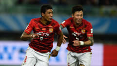 OSAKA, JAPAN - DECEMBER 13:  Paulinho of Guangzhou Evergrande FC celebrates with team mate Zhang Linpeng after scoring the winning goal during the FIFA Club World Cup Japan 2015 quarter final between Club America and Guangzhou Evergrande FC at Osaka Nagai Stadium on December 13, 2015 in Osaka, Japan.  (Photo by Mike Hewitt - FIFA/FIFA via Getty Images)