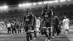 OSAKA, JAPAN - DECEMBER 13: (Editors Note: This image has been turned black and white) Salif Coulibaly and Roger Assale of  TP Mazembe walk off at half time during the FIFA Club World Cup Quarter Final match between TP Mazembe and Sanfrecce Hiroshima at Osaka Nagai Stadium on December 13, 2015 in Osaka, Japan.  (Photo by Matthew Lewis - FIFA/FIFA via Getty Images)