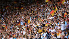 BIELEFELD, GERMANY - AUGUST 01: Supporters of Germany cheer during the 2010 FIFA Women's World Cup Final match between Germany and Nigeria at the FIFA U-20 Women's World Cup stadium August 01, 2010 in Bielefeld, Germany. (Photo by Martin Rose - FIFA/FIFA via Getty Images)