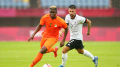 RIFU, MIYAGI, JAPAN - JULY 28: Idrissa Doumbia #7 of Team Ivory Coast runs with the ball whilst under pressure from Marco Richter #7 of Team Germany during the Men's Group D match between Germany and Cote d'Ivoire on day five of the Tokyo 2020 Olympic Games at Miyagi Stadium on July 28, 2021 in Rifu, Miyagi, Japan. (Photo by Alex Livesey - FIFA/FIFA via Getty Images)