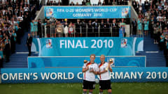 Kim Kulig and Alexandra Popp of Germany pose with their trophees after winning the FIFA U20 Women's World Cup Final match between Germany and Nigeria at the FIFA U-20 Women's World Cup stadium on August 1, 2010 in Bielefeld, Germany. (Photo by Friedemann Vogel - FIFA/FIFA via Getty Images)