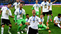 SAINT PETERSBURG, RUSSIA - JULY 02: Joshua Kimmich of Germany celebrates with the FIFA Confederations Cup trophy after the FIFA Confederations Cup Russia 2017 Final between Chile and Germany at Saint Petersburg Stadium on July 2, 2017 in Saint Petersburg, Russia.  (Photo by Stuart Franklin - FIFA/FIFA via Getty Images)