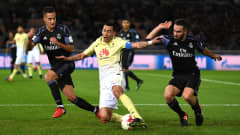YOKOHAMA, JAPAN - DECEMBER 15:  Rubens Sambueza of Club America is tackled by Daniel Carvajal of Real Madrid (R) and Lucas Vazquez of Real Madrid (L) during the FIFA Club World Cup Semi Final match between Club America and Real Madrid at International Stadium Yokohama on December 15, 2016 in Yokohama, Japan.  (Photo by Mike Hewitt - FIFA/FIFA via Getty Images)