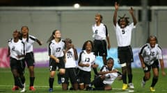 SINGAPORE - AUGUST 23: Trinidad & Tobago team celebrate as Georgina Kaikas of Papua New Guinea has her penalty saved during the 5th/6th place match between Papua New Guinea and Trinidad & Tobago in the Girls Youth Olympic Football Tournament at the Jalan Besar Stadium on August 23, 2010 in Singapore, Singapore. (Photo by Julian Finney - FIFA/FIFA via Getty Images)