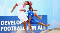 ESPINHO, PORTUGAL - JULY 18: Angelo Tchen of Tahiti is challenged by Paolo Palmacci of Italy during the FIFA Beach Soccer World Cup Portugal 2015 Semi-final match between Italy and Tahiti at Espinho Stadium on July 18, 2015 in Espinho, Portugal.  (Photo by Alex Grimm - FIFA/FIFA via Getty Images)