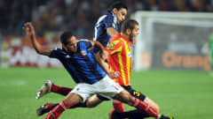 Esperance forward Chaker Zouaghi vies for the ball against al-Ahly players Walid Suleiman