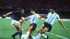 1990 World Cup Semi Final, Naples, Italy, 3rd July, 1990, Argentina 1 v Italy 1 (Argentina win 3-2 on penalties), Italy's Roberto Donadoni is challenged for the ball by Argentina's Juan Ernesto Simon and Jose Basualdo (Photo by Bob Thomas/Getty Images)