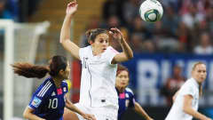FRANKFURT AM MAIN, GERMANY - JULY 17: Kozue Ando (R) and Homare Sawa (L) of Japan and Carli Lloyd (C) of USA battle for the ball during the FIFA Women's World Cup Final match between Japan and USA at the FIFA World Cup stadium Frankfurt on July 17, 2011 in Frankfurt am Main, Germany.  (Photo by Joern Pollex/Getty Images)