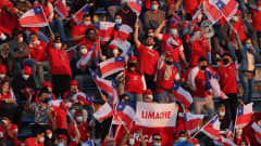 SANTIAGO, CHILE - OCTOBER 10: Fans of Chile cheer for their team before a match between Chile and Paraguay as part of South American Qualifiers for Qatar 2022 at Estadio San Carlos de Apoquindo on October 10, 2021 in Santiago, Chile. (Photo by Elvis Gonzalez - Pool/Getty Images)