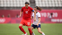 KASHIMA, JAPAN - AUGUST 02: Christine Sinclair #12 of Team Canada is closed down by Kelley O'Hara #5 of Team United States during the Women's Semi-Final match between USA and Canada on day ten of the Tokyo Olympic Games at Kashima Stadium on August 02, 2021 in Kashima, Ibaraki, Japan. (Photo by Hector Vivas - FIFA/FIFA via Getty Images)