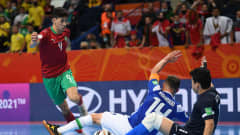 VILNIUS, LITHUANIA - SEPTEMBER 26: Youssef Jouad of Morocco battles for possession with Rodrigo and Guitta of Brazil during the FIFA Futsal World Cup 2021 Quarter Final match between Morocco and Brazil at Vilnius Arena on September 26, 2021 in Vilnius, Lithuania. (Photo by Alexander Scheuber - FIFA/FIFA via Getty Images)