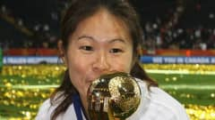 Homare Sawa of Japan kisses the trophy after weinning 5-3 after penalty shoot-out the FIFA Women's World Cup Final match between Japan and USA at the FIFA World Cup stadium Frankfurt on July 17, 2011 in Frankfurt am Main, Germany. (Photo by Christof Koepsel/Getty Images)
