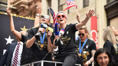 NEW YORK, NEW YORK - JULY 10: Ali Krieger and Megan Rapinoe celebrate during a Victory Ticker Tape Parade for the U.S. Women's National Soccer Team down the Canyon of Heroes on July 10, 2019 in the Manhattan borough of New York City. The USA defeated the Netherlands on Sunday to win the 2019 FIFA Women's World Cup France. (Photo by Theo Wargo/Getty Images)