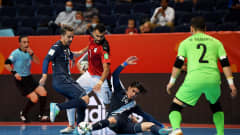 VILNIUS, LITHUANIA - SEPTEMBER 15: Mohamed Mansour of Egypt breaks past Wanderley Ruiz of Guatemala during the FIFA Futsal World Cup 2021 group B match between Egypt and Guatemala at Vilnius Arena on September 15, 2021 in Vilnius, Lithuania. (Photo by Alexander Scheuber - FIFA/FIFA via Getty Images)