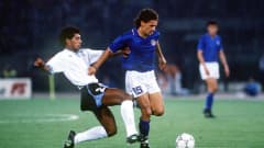 Italy's Roberto Baggio attempts to escape from Ruben Pereira of Uruguay during their Round of 16 game at theFIFA World Cup™ on 25 June 1990. Gli Azzurri won 2-0 thanks to goals from Toto Schillaci and Aldo Serena.